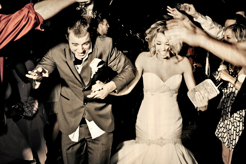 Throwing Rice Exit Wedding Shot